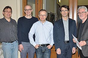 Reinhard Alkofer, Sprecher des Forschungsschwerpunkts Modelle und Simulation, die Referenten Stefan Schaefer, Volker Springel und Christoph Dellago mit Workshop-Organisator Christian Lang (v.l.)